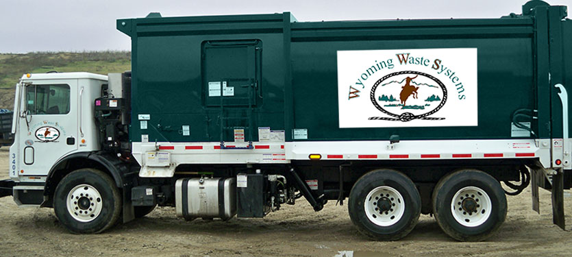 Wyoming Waste Systems rear load garbage truck.